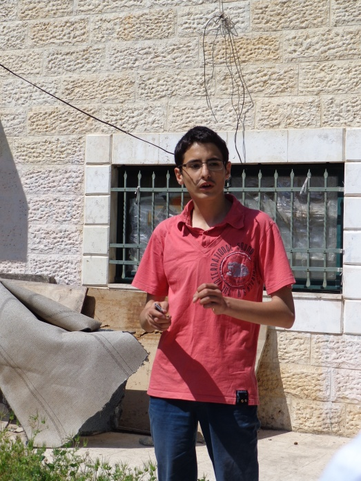 Mohammed al Kurd, standing outside his family's home in the East Jerusalem neighbourhood of Sheikh Jarrah.  Israeli settlers took over the front part of their house, leaving the family to live in the back.