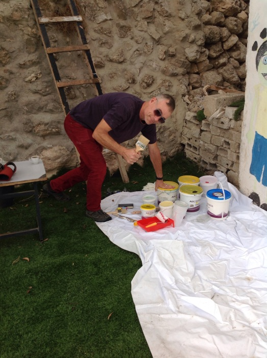 British artist Mark Sands preparing the paints on the first day.